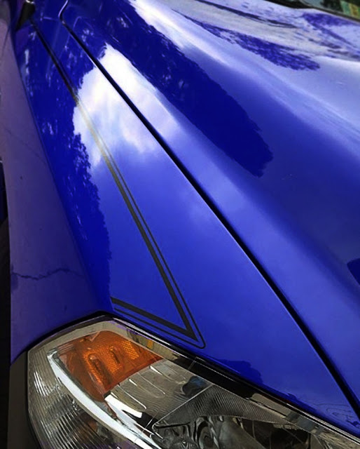 blue-dodge-ram-with-black-pinstripe