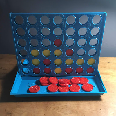 Photo of the knock-off Connect 4 game that broke when I tried t put it together