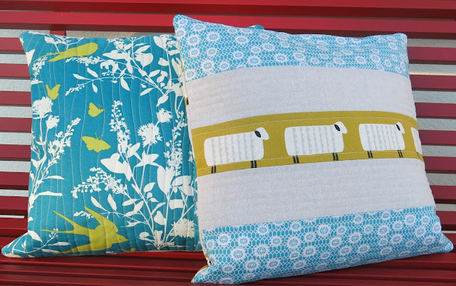 Teal and mustard yellow quilted cushions - On the bench