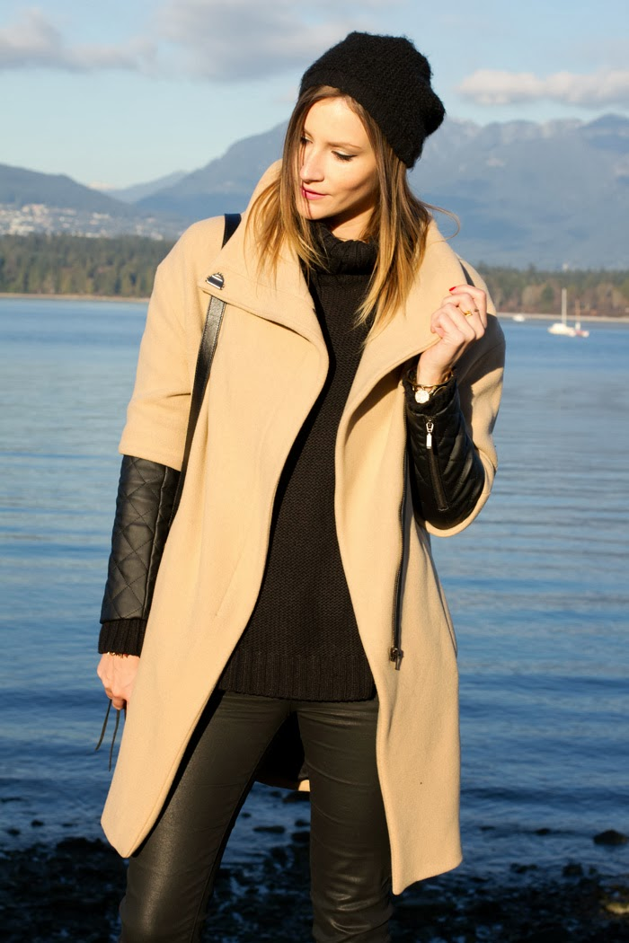 Fashion Blogger, Alison Hutchinson, is wearing a leather sleeve coat from Zara, H&M chunky turtleneck sweater, Current/Elliot wax coated jeans, Vince Camuto tan booties, a Rebecca Minkoff Leopard Print Bag, Michael Kors slim Runway Watch, and a Kate Spade gold bracelet