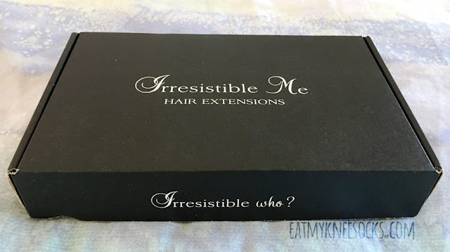 Details on the Silky Touch clip-in hair extensions from IrresistibleMe, shown in natural black.