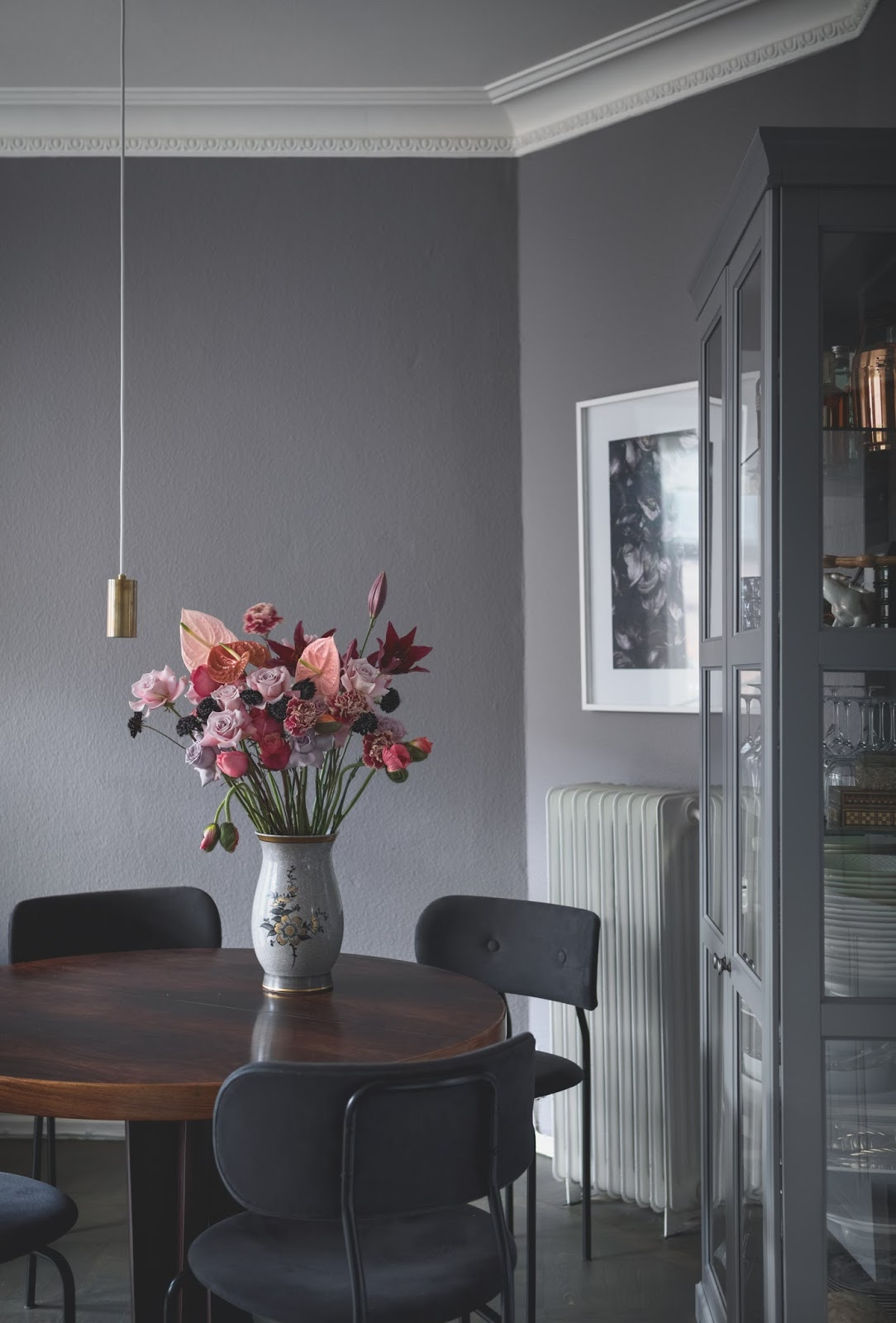 dark painted walls inside of an amazing scandinavian apartment, dining room