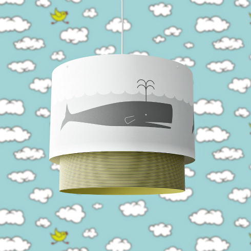 pendant light with a whale motif on the paper drum shade