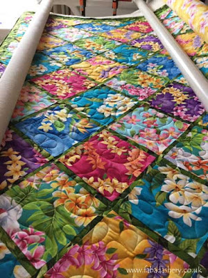 Holly's Hawaiian quilt on the APQS Longarm Quilting Frame