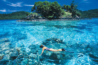 Fiji Island a girl swimming in water