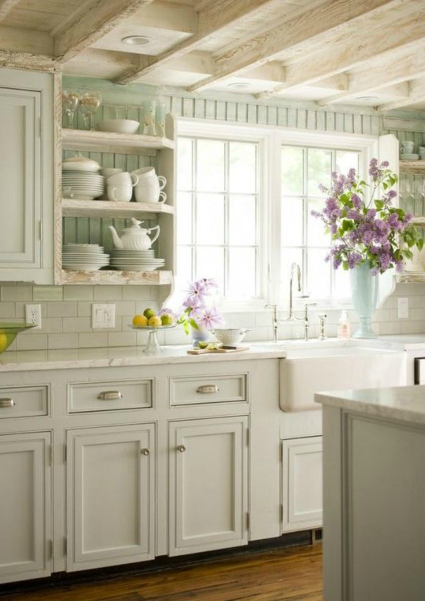 Gorgeous white kitchen with country decoor and aqua painted beadboard - found on Hello Lovely Studio