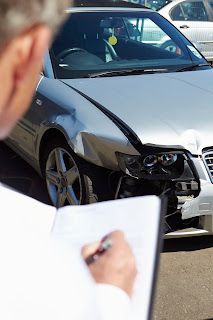 An insurance adjuster take information for an auto accident claim.