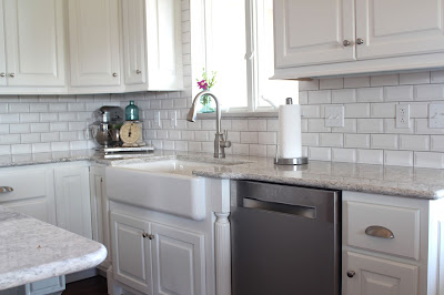 Kithcen remodel with custom cabinets, beveled subway tile and Cambria Berwyn quartz and farmhouse sink