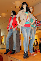 A trio of store mannequins.