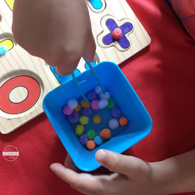 number puzzles, pom pom and tweezers