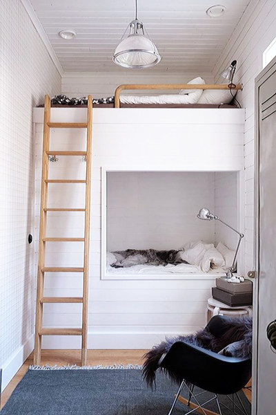 bunk beds covered with shiplap