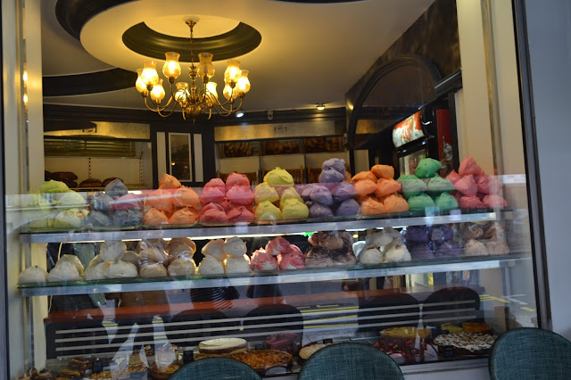 Colourful French meringues in Parisian shop windows