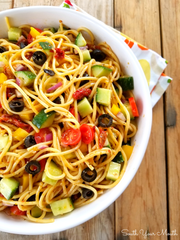 Spaghetti Salad! A fun, unique and beautiful pasta salad recipe made with spaghetti noodles bursting with Italian flavor and flare that will become a quick favorite because it's so easy to prepare!