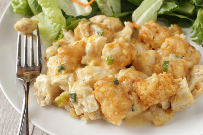 """Crock-Pot Cheesy Chicken Ranch Tater Tot Casserole. This recipe is one of my kids favorites and something I make, oh, about once a month. Even Parker my """"I hate casseroles"""" kid is fond of this one as long as I don't mention the word casserole."""