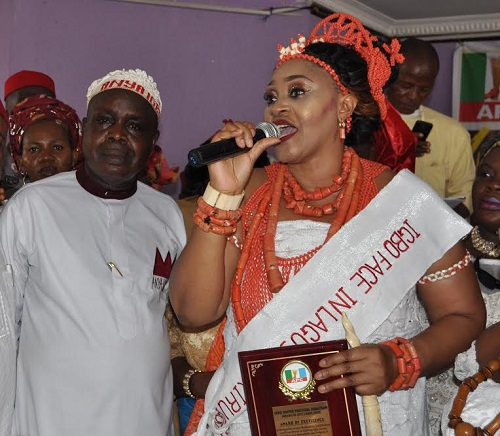 Chief   Chris Ekwilo , the Anya Igbo  and the  President  of  Igbo speaking Community in Lagos state  felicitating with the  new FACE OF IGBO in  LAGOS , Princess Ada Okeke-Amam at the National stadium Lagos after her award