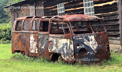 No windows, no paint or drivetrain. Rusty burned T1 Transporter hulk is still a head turner.