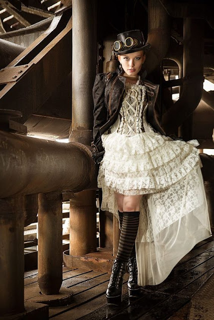 Women's steampunk ivory lace skirt with corset, jacket, boots, top hat and goggles. Steampunk fashion inspiration for women.