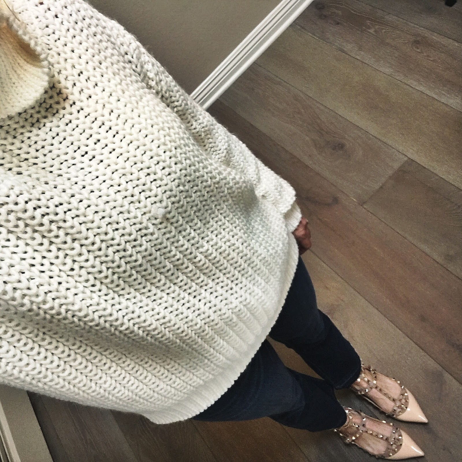 white oversized turtleneck and rockstuds