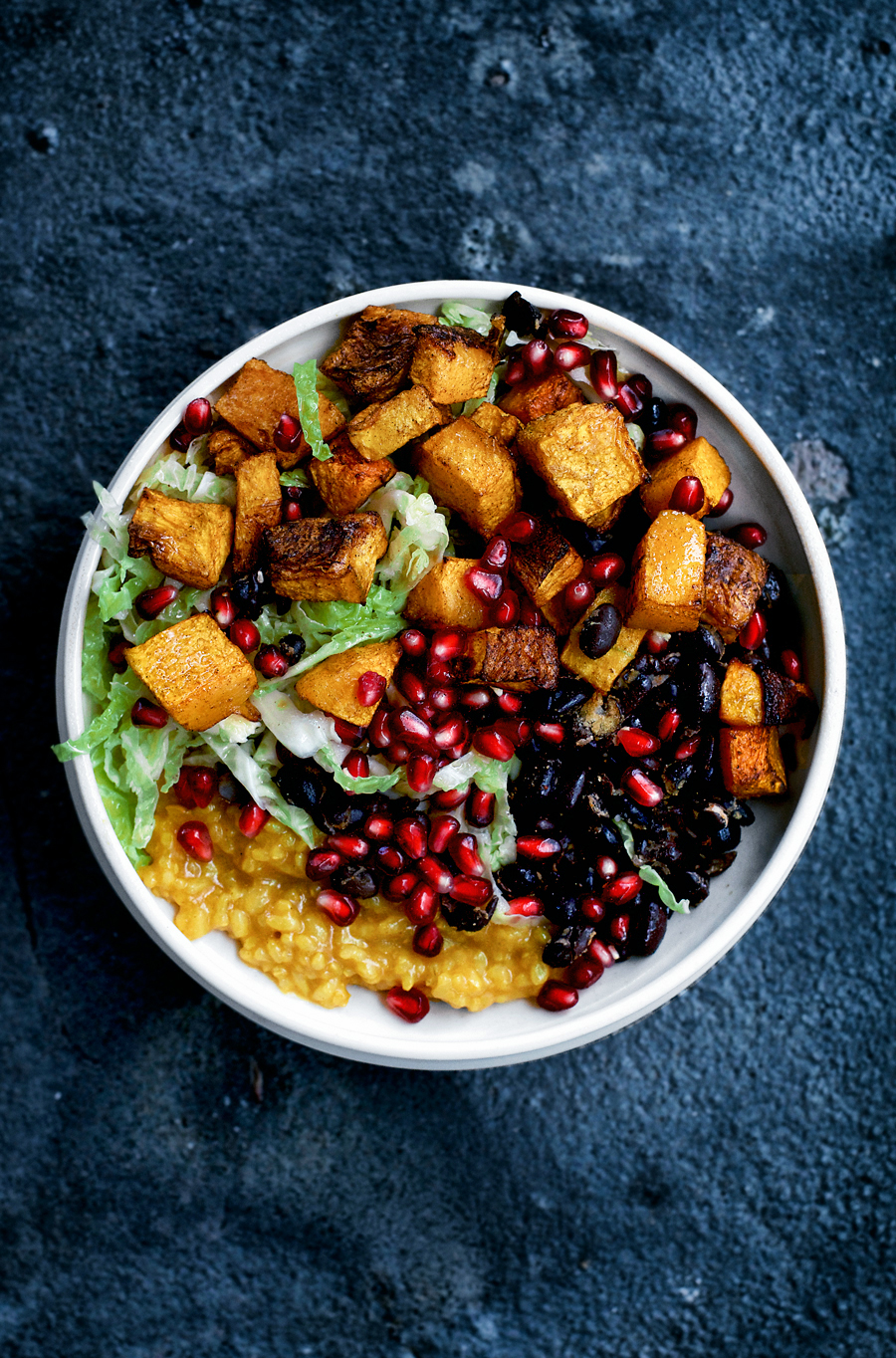 This vegan autumn bowl is filled with butternut squash, cabbage, pomegranate, and my favourite turmeric rice. Spicy, colourful, and simple, this is comfort food at its best.