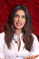 Priyanka Chopra in White Shirt and Colorful Skirt at Baywatch Press Conference  15th May 2017 ~  Exclusive 11.jpg