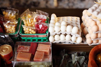 Detail of stock in a modern dolls' house miniature Hong Kong grocery shop.