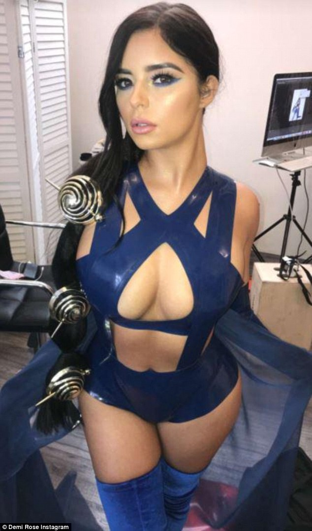 Demi-Rose-flaunts-jaw-dropping-cleavage-in-racy-PVC-costumes