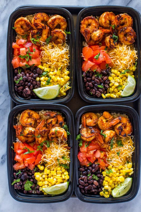 Insanely delicious spicy taco spiced shrimp bowls loaded with cheese, black beans, corn, brown rice and tomato. Make a week's worth of lunch in under 30 minutes. Shrimp tacos on a weekday just happened. Lighter,