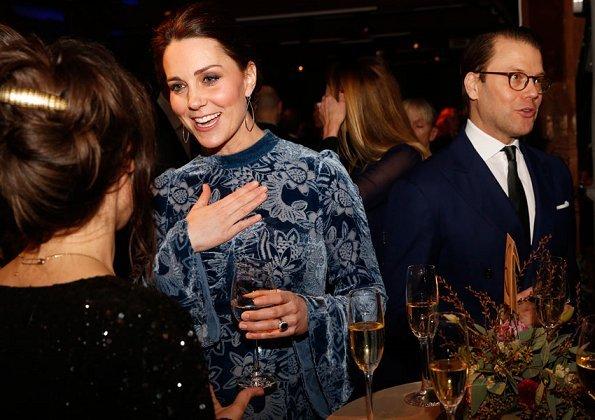 Kate Middleton wore ERDEM Christina Devore Velvet Midi Dress. The Duchess wore a black coat by well known Swedish designer Ida Sjöstedt. Crown Princess Victoria