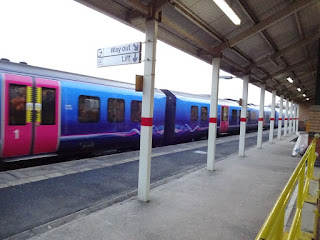 One of the non-stopping trains passing through Ashton-under-Lyne station