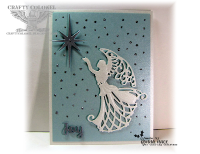 CraftyColonel Donna Nuce for CASE-ing Christmas challenge blog, Spellbinders Angel of Peace and Holiday Sentiments, Memory Box Traditional Stars., Christmas Card.