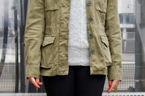 Army jacket, mint sweater, black skinny jeans