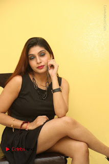 Tollywood Upcoming Actress Pooja Roshan Stills in Black Short Dress at Plus 1 Movie Trailer Launch  0278.JPG