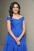 Actress Ritu Varma Pos in Blue Short Dress at Keshava Telugu Movie Audio Launch .COM 0045.jpg
