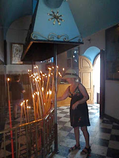 Pat Lighting Candle Panagia Evangelistria Cathedral Tinos Greece