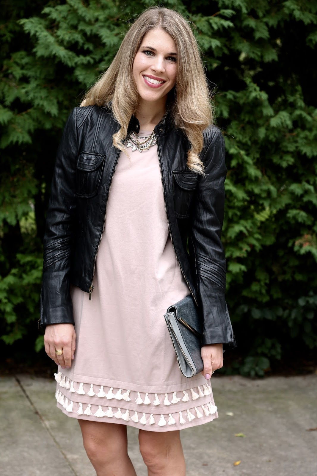 Blush tassel dress, lace up snakeskin heels, grey envelope clutch, black moto jacket,