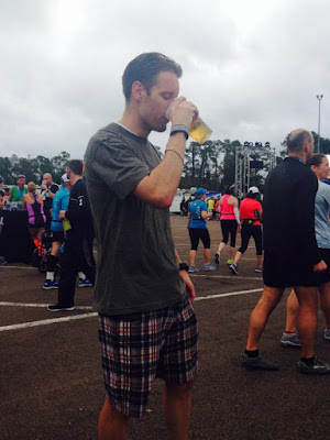 Joseph P. Fisher drinking a beer at the Run Disney race series