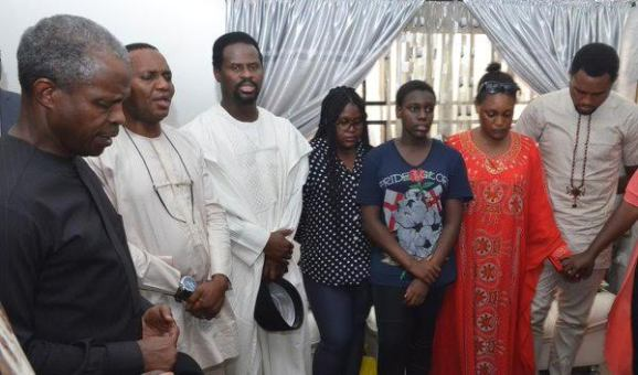 Photo: Vice President Yemi Osinbajo prays with surviving children of late James Ocholi