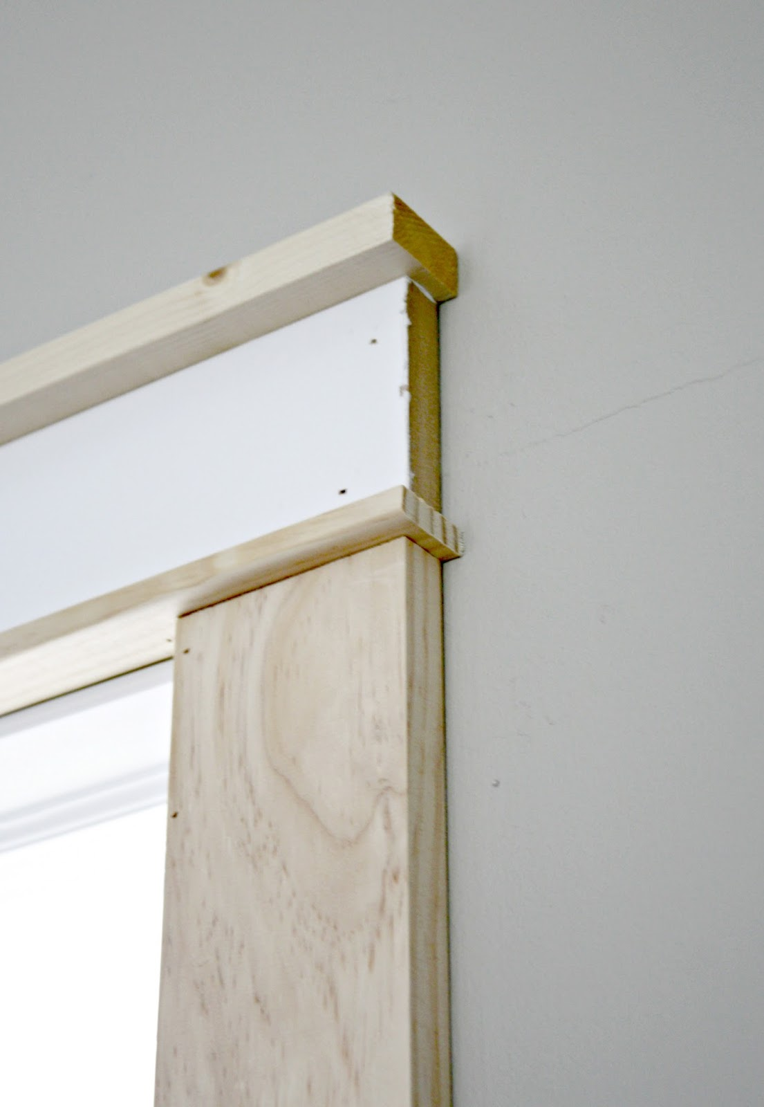 DIY craftsman trim & Hardwoods in the loft and adding farmhouse door trim from Thrifty ...