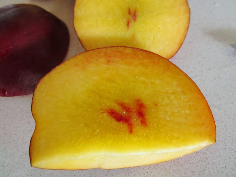 Close up of some cut nectarines
