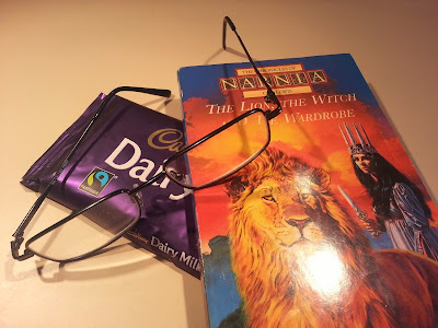 Glasses, chocolate and book