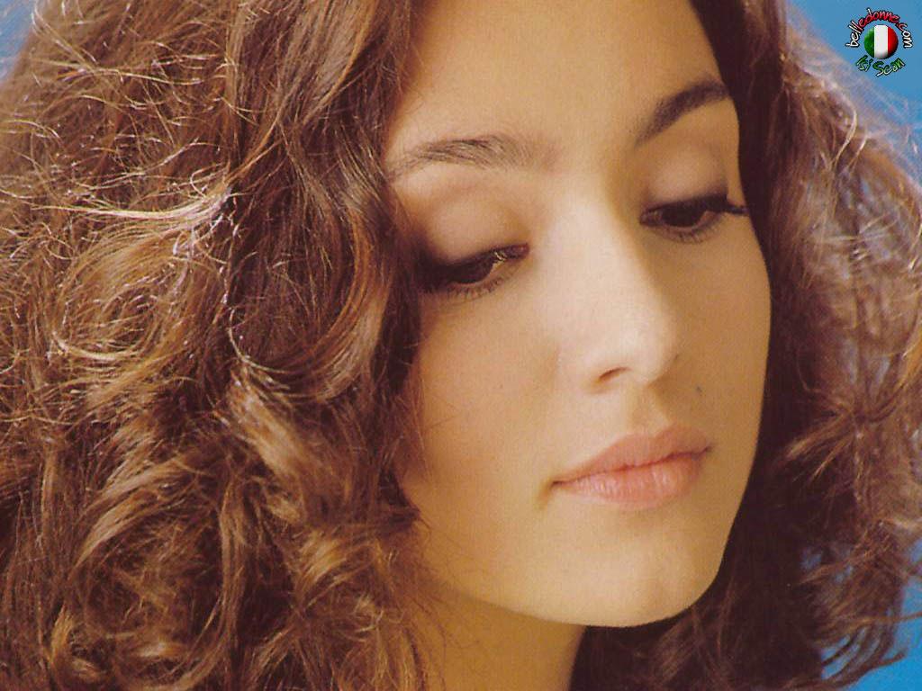image Beautiful italian girl plays with her big clear dildo