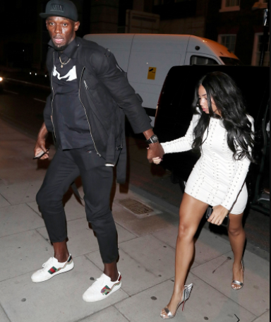 """""""Holy cannoli!, does any one know what that stain on Usain Bolt's pant is as he exits club with girlfriend Kasi Bennett """""""