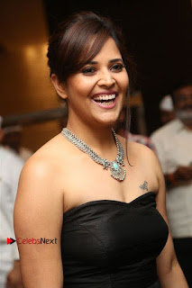 Telugu Anchor Actress Anasuya Bharadwa Stills in Strap Less Black Long Dress at Winner Pre Release Function  0023.jpg