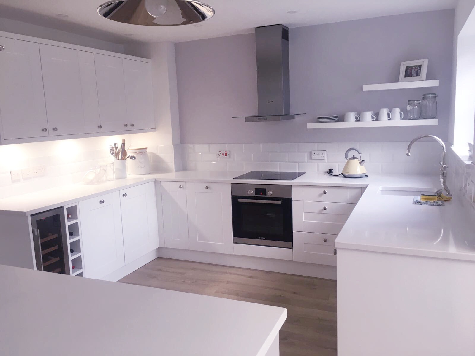 White shaker style kitchen cleaned and clutter free