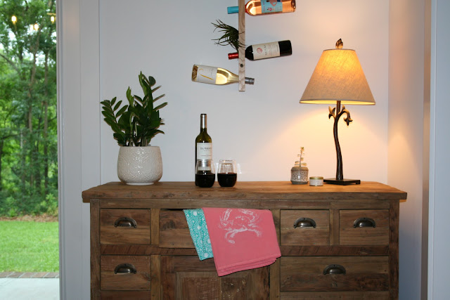 Buffet and vertical floating wine bottle holder with air plants   The Lowcountry Lady