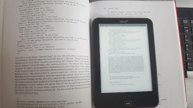 EBookreader auf Buch