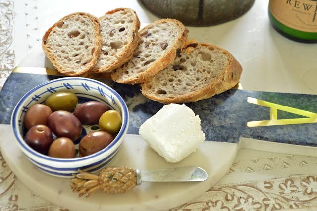 Peplums & Pie: Honey Goat Cheese and Greek Olive Baguette // Anthropologie marble monogram cheese board // greek olives //peplumsandpie.com