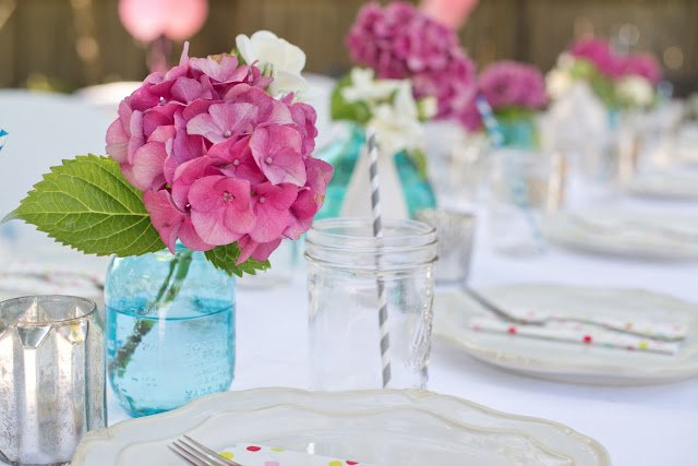 pink hydrangeas and blue canning jars