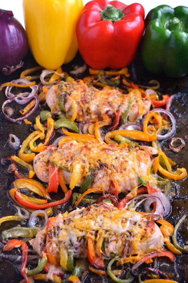 Hasselback Fajita Chicken features bell pepper and onion stuffed chicken breasts with fajita seasonings and melted cheese along with roasted peppers and onions all cooked on one pan for an easy and flavorful meal! www.nutritionistreviews.com
