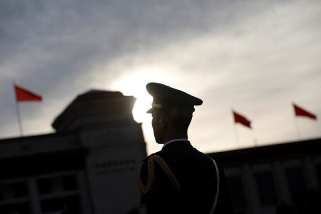 Image Attribute:  A security personnel stands guard ahead of the opening session of the National People's Congress (NPC) outside the Great Hall of the People in Beijing, China, March 5, 2017. REUTERS/Tyrone Siu